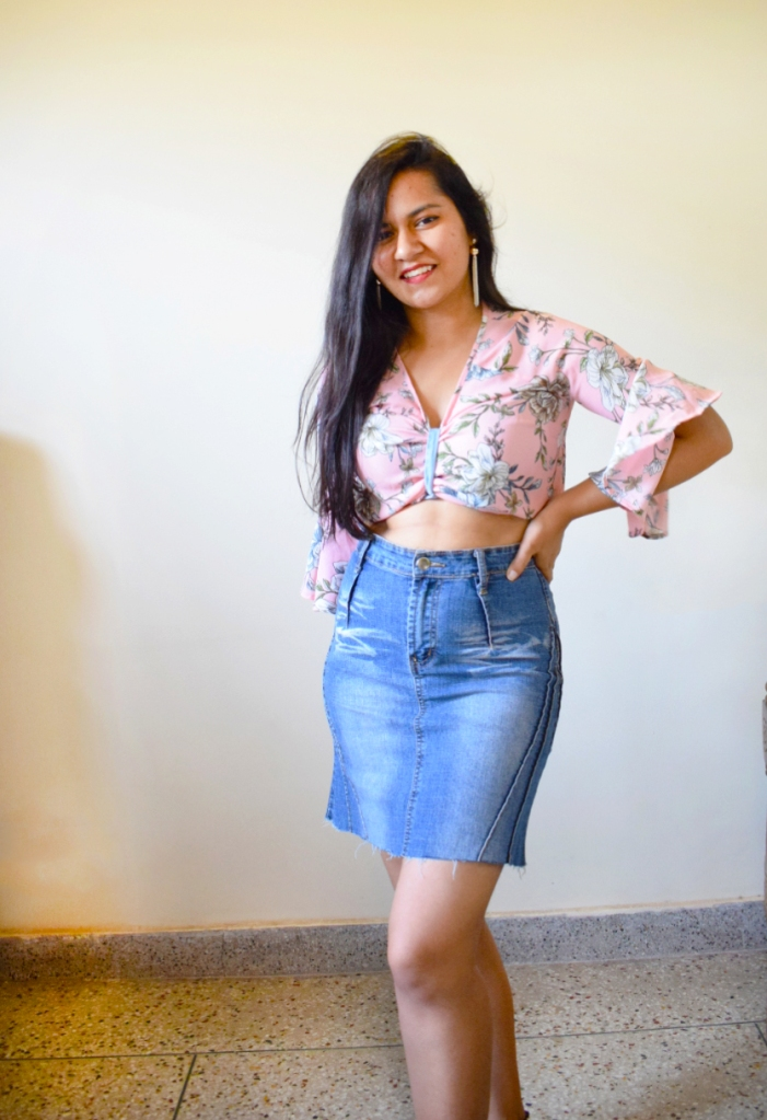 Cute floral top styled with denim skirt